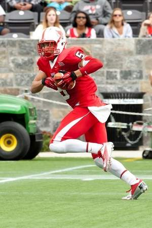 Mike Rios runs with the football while playing for Marist College at Tenney Stadium at Leonidoff Field. / Courtesy Marist Athletics Department