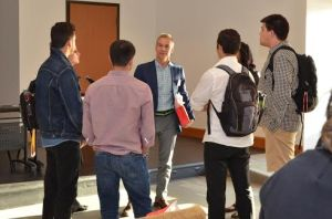 Students speak with panelist member Fred Dever, '87, Territory Business Manager for Merz Pharmaceuticals.  Photo Courtesy of Katie Monahan