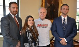 "Marist President Dennis J. Murray wearing the ""Fox Company"" T-shirt that the Marist Student Veterans Organization (MSVO) is selling to support the Gulliver's Travel fundraising campaign. From left, Owen Daly '05, Marine veteran and advisor to MSVO, Marine veteran and MSVO President Britany Diesing '16, President Murray, and Matt Plumeri '16."