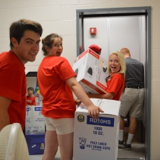 A group of volunteers loading the Champagnat elevators of boxes and bins belonging to the freshmen students.