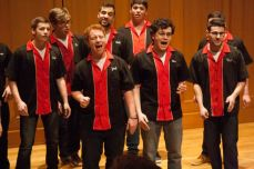 Seniors Zach Russo (center) and Andrew Brown (center right) perform with their a cappella group, Time Check.