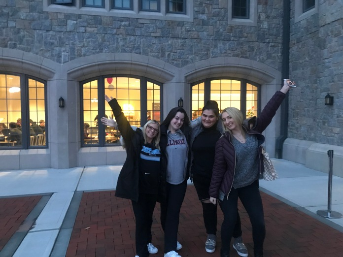 My friends posing in front of the North End Dining Hall at the Grand Opening